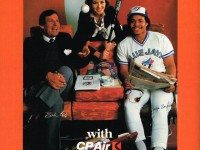 Bobby Cox and Jesse Barfield enjoy the amenities of flying CP Air. Advertisement, Blue Jays 1985 Scorebook Magazine.