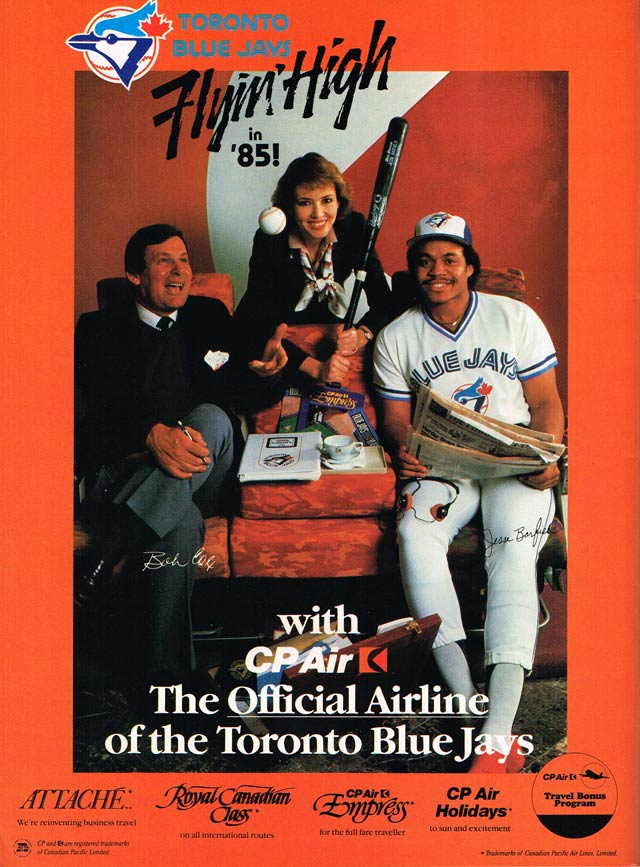Bobby Cox and Jesse Barfield enjoy the amenities of flying CP Air  Advertisement, Blue Jays 1985 Scorebook Magazine
