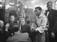 Calypso singer Lord Caresser visits diners at the Rockhead's nightclub in Montreal, April 28, 1951. Photo by Louis Jaques in Weekend Magazine from the Library and Archives Canada.