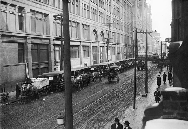 Delivery trucks lining Richmond Street, looking east towards Yonge Street, February 19, 1913. From the City of Toronto Archives, Fonds 1231, Item 1266.