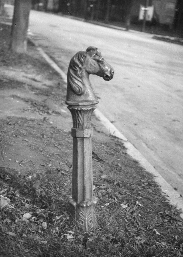 Hitching post on Wellington Street, November 1931. From the City of Toronto Archives, Fonds 1548, Series 393, Item 23619.