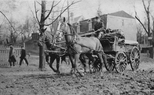 After this fire wagon got stuck on a muddy Earlscourt road, ca. 1912, the firemen had to walk a half-mile to the blaze. From the City of Toronto Archives, Fonds 1244, Item 7282.