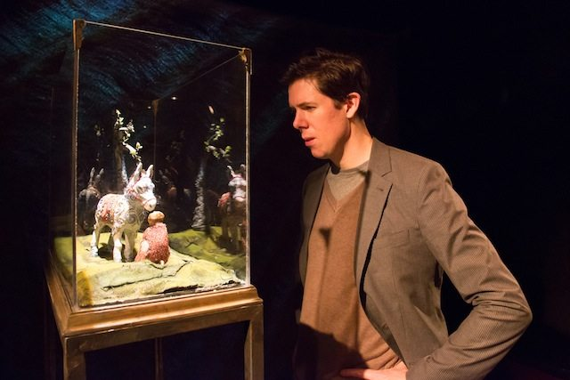 Damien Atkins as Henry, peering at a taxidermied donkey and ape, Beatrice and Virgil. Photo by Joanna Akyol.