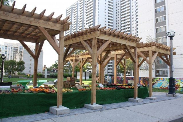 New highrise apartment  zoning rules hope to encourage local services like this food stand in St  Jamestown  Photo courtesy of City of Toronto, Tower Renewal Office