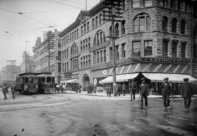 Sikh men crossing the street at Granville and Hastings streets in Vancouver, 1908  Photo by Philip Timms from the Vancouver Public Library