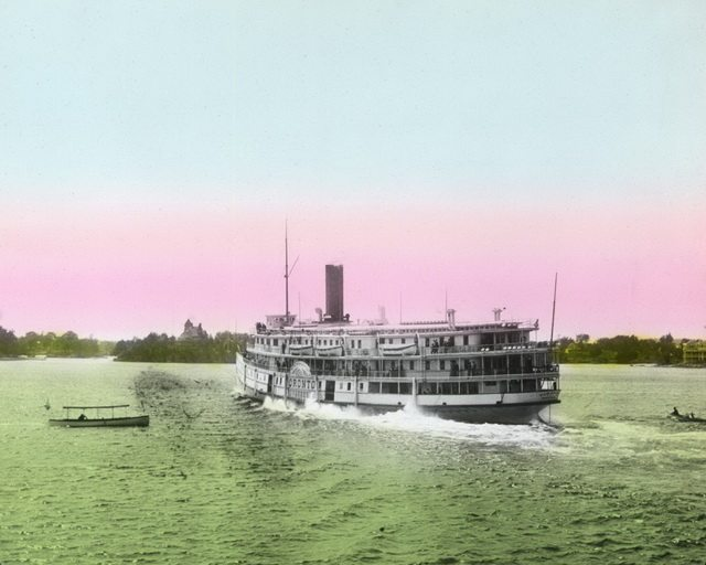Coloured magic lantern slide of the steamer Toronto in the Thousand Islands off Alexandria Bay, N Y , ca  1900  From Walter Lewis' Maritime History of the Great Lakes