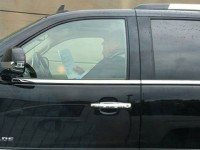 Rob Ford drives his Escalade while apparently reading, in this photo from 2012. Photo from Twitter user RyanGHaughton.