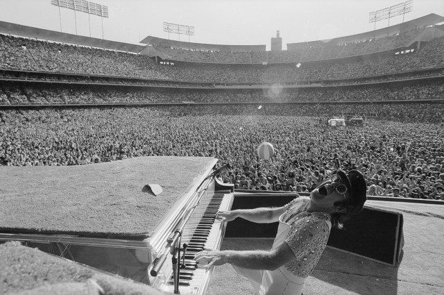 Elton John entertaining the masses. Photo by Terry O'Neill.