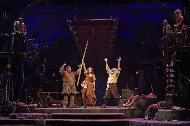 Steve Ross as Manservent/Sancho Panza, Robin Hutton as Aldonza/Dulcinea and Tom Rooney as Miguel de Cervantes/Don Quixote with members of the company in Man of La Mancha  Photo by Michael Cooper