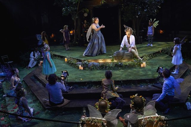Jonathan Goad as Titania (sharing the role with Evan Buliung) and Stephen Ouimette as Bottom with members of the company in Chris Abrahama's A Midsummer Night's Dream. Photo by Michael Cooper.