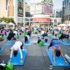 Get your stretch on at Yonge-Dundas Square for a good cause at Yogathon. Image courtesy of Yogathon Toronto.