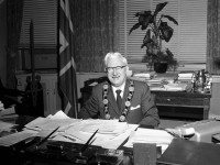 Mayor Nathan Phillips wearing chain of office in his (Old) City Hall office. City of Toronto Archives, Fonds 1257, Series 1057, Item 3996.