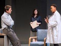 Ari Cohen, Jenny Young and Warona Setshwaelo portray doctors treating a sick baby in Tarragon Theatre's Waiting Room. Photo by Cylla von Tiedemann.