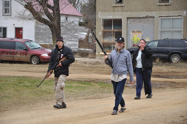 Craig Cobb (centre) and his tenants patrol Leith, North Dakota in Welcome to Leith