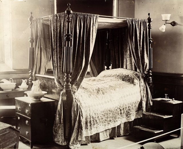 Antique bed owned by Mrs  Macdonald—with stairs for climbing in—displayed at the Canadian Historical Exhibition, 1899  From the Toronto Public Library's Digital Collection