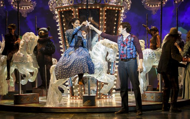 Alexis Gordon as Julie Jordan and Jonathan Winsby as Billy Bigelow with members of the company in Carousel  Photo by David Hou