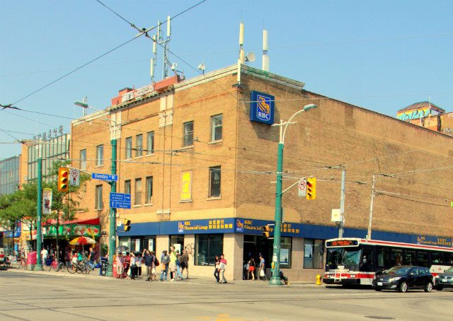 Detail from photo of northeast corner of Dundas West and Spadina, August 3, 2012, by wyliepoon from Flickr via Creative Commons