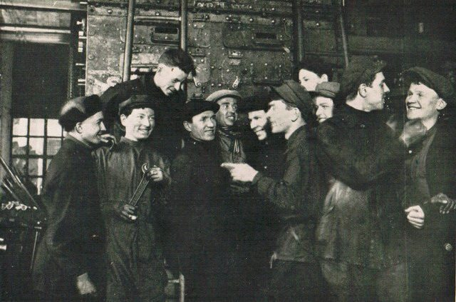 A group of Communist Youth in a Machine Factory from William Henry Chamberlin, Soviet Russia—A Living Record and a History (Little, Brown and Company, 1930)