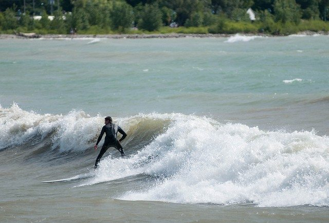 Photo of a surfer at Woodbine Beach  By Bruce K from the Torontoist Flickr Pool