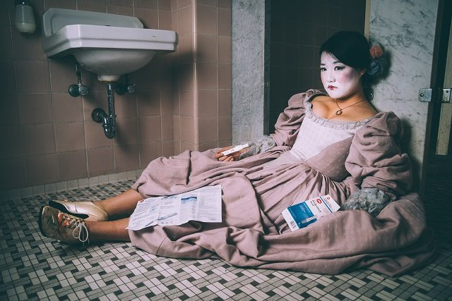 Rong Fu plays the mysteriously pregnant title character in Red Light District's postmodern comedy The Marquise of O—  Photo by Alejandro Santiago