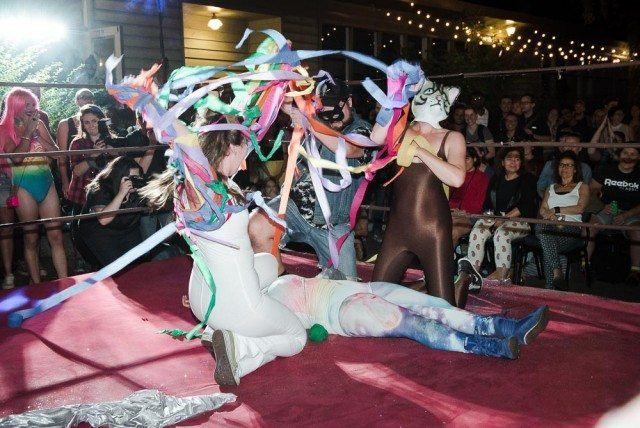 "A ""rainbow evisceration"" of a Lady Wrestler. Photo by Kevin Jones/Torontoist."