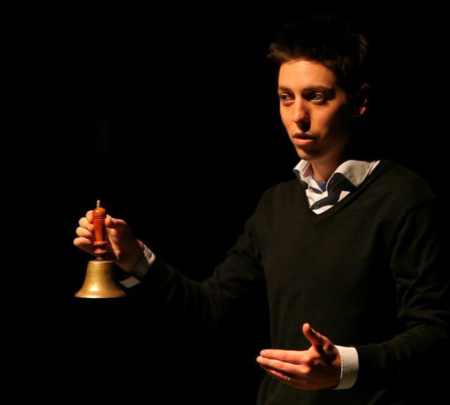 Nicholas Wallace explains the spirit bell in Seance  Photo courtesy of Red Eye Media