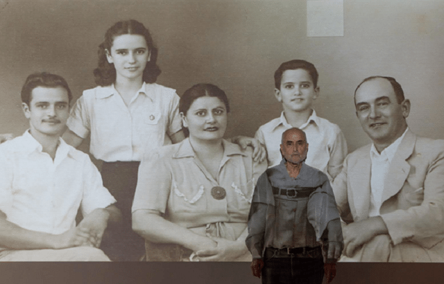 Nir Bareket stands in front of a family portrait that inspired his memoir turned play They Say He Fell   Photo courtesy of Pandemic Theatre