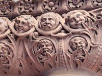 Carved personally and installed in secret by Lennox, architect for the late and over-budget 'Richardsonian Romanesque Revival' structure and in financial dispute with the city council.