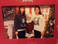 Torontoist contributor Sarah Duong (right) visits the Loblaws Santa along with Helen (left).