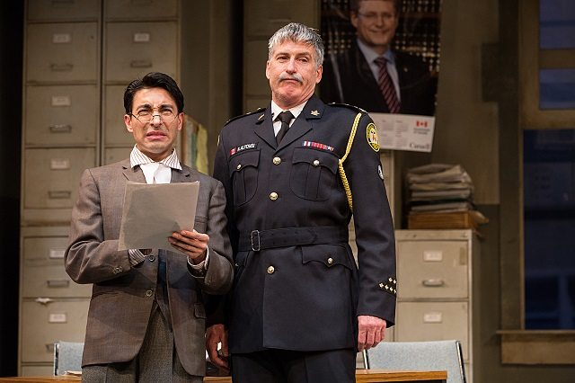 Kawa Ada, left, and Rick Roberts made a mockery of the law in Soulpepper Theatre's raucous set in Toronto revival of Accidental Death of an Anarchist  Photo by Cylla von Tiedemann
