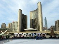 At Nathan Phillips Square, waiting skaters watch a zamboni clear the ice.