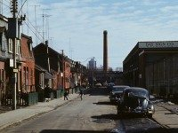 A run-down residential street, adjacent to light industrial, in the east-end of Toronto, ca. 1970. Photo by Robert and Harold Stacey. From the City of Toronto Archives, Fonds 2, Series 8, Subseries 4, File 5.