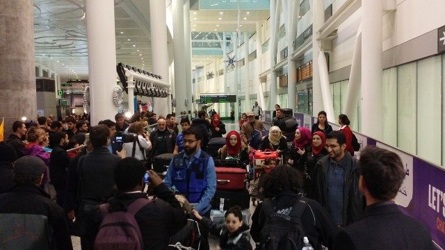 First planeload of Syrian refugees arrive in Toronto  Photo by Domnic Santiago from the Torontoist Flickr Pool
