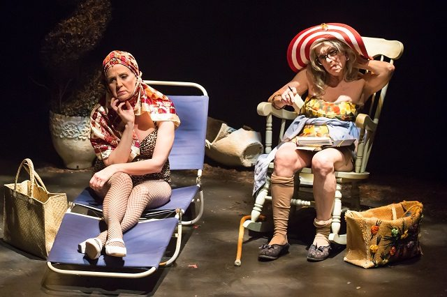 Lisa Horner, left, as Little Edie and Nicola Lipman as her mother, Big Edie, bask in the sun in a scene from Acting Up Stage's production of Grey Gardens  Photo by Racheal McCaig Photography
