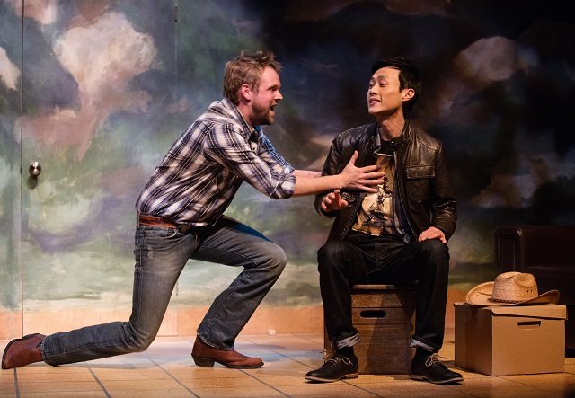 TJ Riley and  Jonathan Tan in a scene from Soulpepper Theatre's production of Cowboy Versus Samurai, part of the company's Studio Series  Photo by Cylla von Tiedemann
