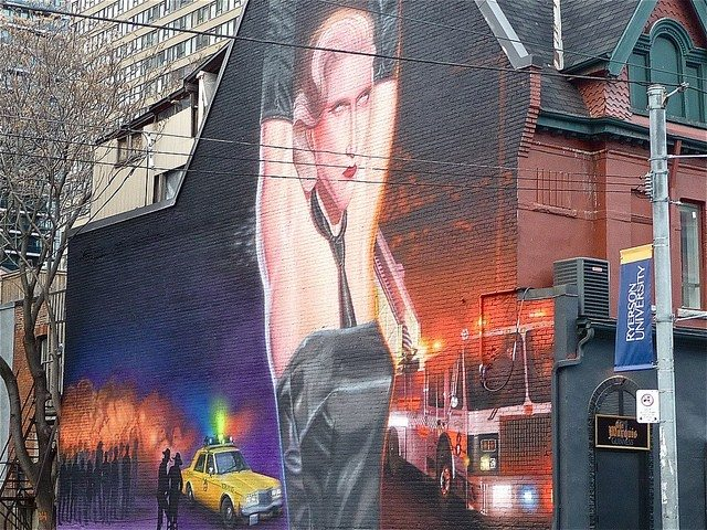 Mural on Church Street depicting the Bathhouse Raids  Photo by Bella from the Torontoist Flickr Pool