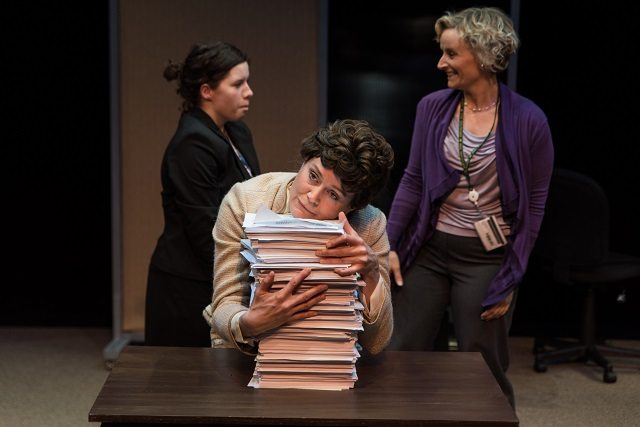 Common Boots and Nightwood Theatre's The Public Servant stars, from left to right, Amy Keating, Amy Rutherford, and Sarah McVie as federal employees  Photo by Neil Silcox
