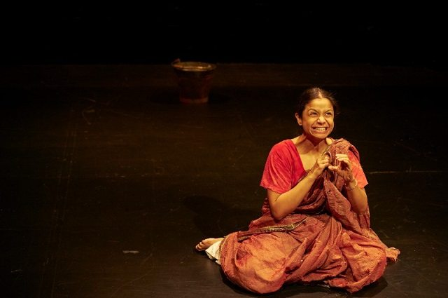Anusree Roy evokes the grim life of India's Dalit caste in her powerful solo show Pyaasa at Theatre Passe Muraille  Photo by Michael Cooper