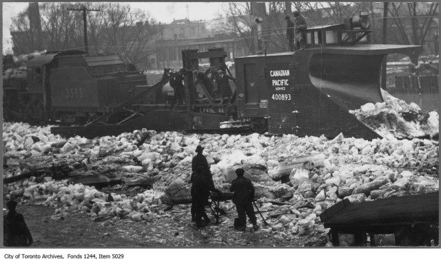 Workers clear ice from the railroad tracks in the Don Valley around 1910. Photo from the Toronto Archives Fonds 1244, Item 5029.