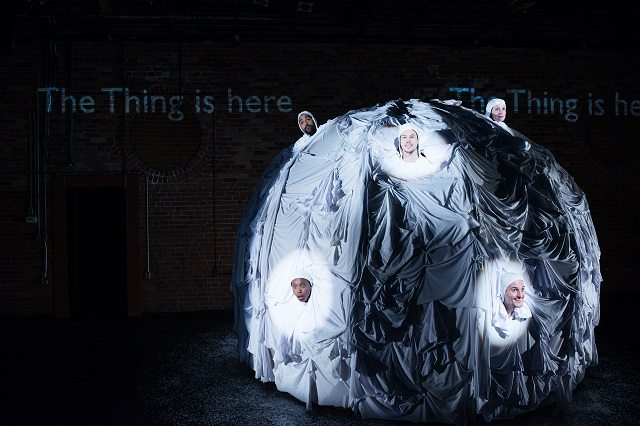 """The cast of Canadian Stage and Theatre Smash's Das Ding (The Thing) in their shared role as the """"Thing"""" of the title. Photo by James Heaslip."""