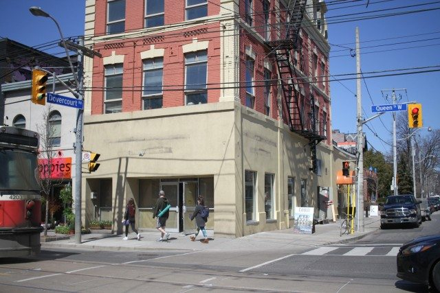 The building located on 1092 Queen Street West, at the corner of Dovercourt Road, after its Starbucks logos have been removed.