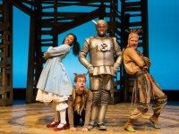 Vanessa Sears as Dorothy, Nathan Carroll as Toto, Matthew G. Brown as the Tinman, and David Coomber as the Scarecrow in a scene from The Wizard of Oz at Young People's Theatre. Photo by Cylla von Tiedemann.