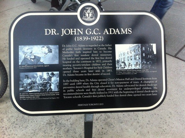 John G.C. Adams (non-dental) plaque at the corner of Bay and Elm Streets, where his free clinic once treated patients. Photo by Laura Carlin.