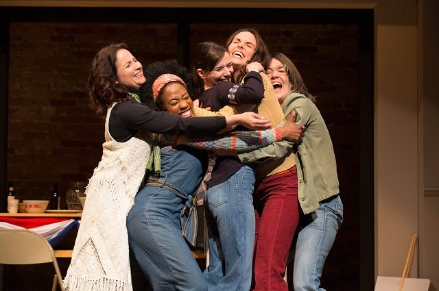 From left: Raquel Duffy, Sophia Walker, Michelle Monteith, Sarah Wilson, and Laura Condlln share a group hug in a scene from The Heidi Chronicles. Photo by Cylla von Tiedemann.