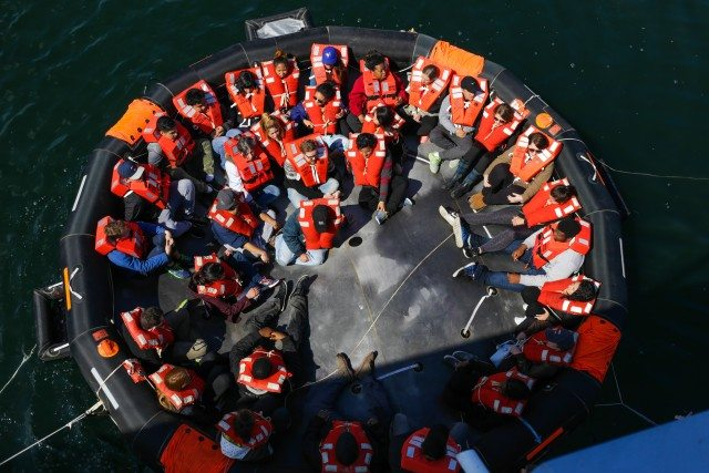 A group of 32 pile on one-at-a-time into a 45-person life raft