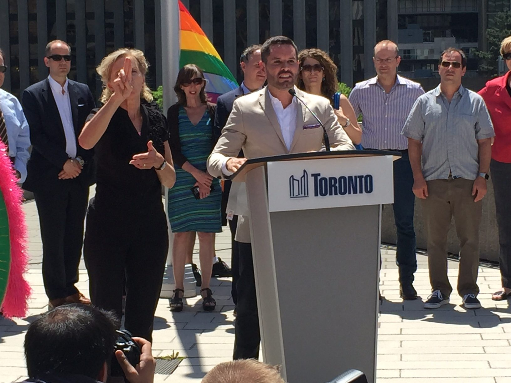 Mathieu Chantelois addresses the crowd, noting that this year's Pride festivities will make Toronto the queerest city for 33 days.