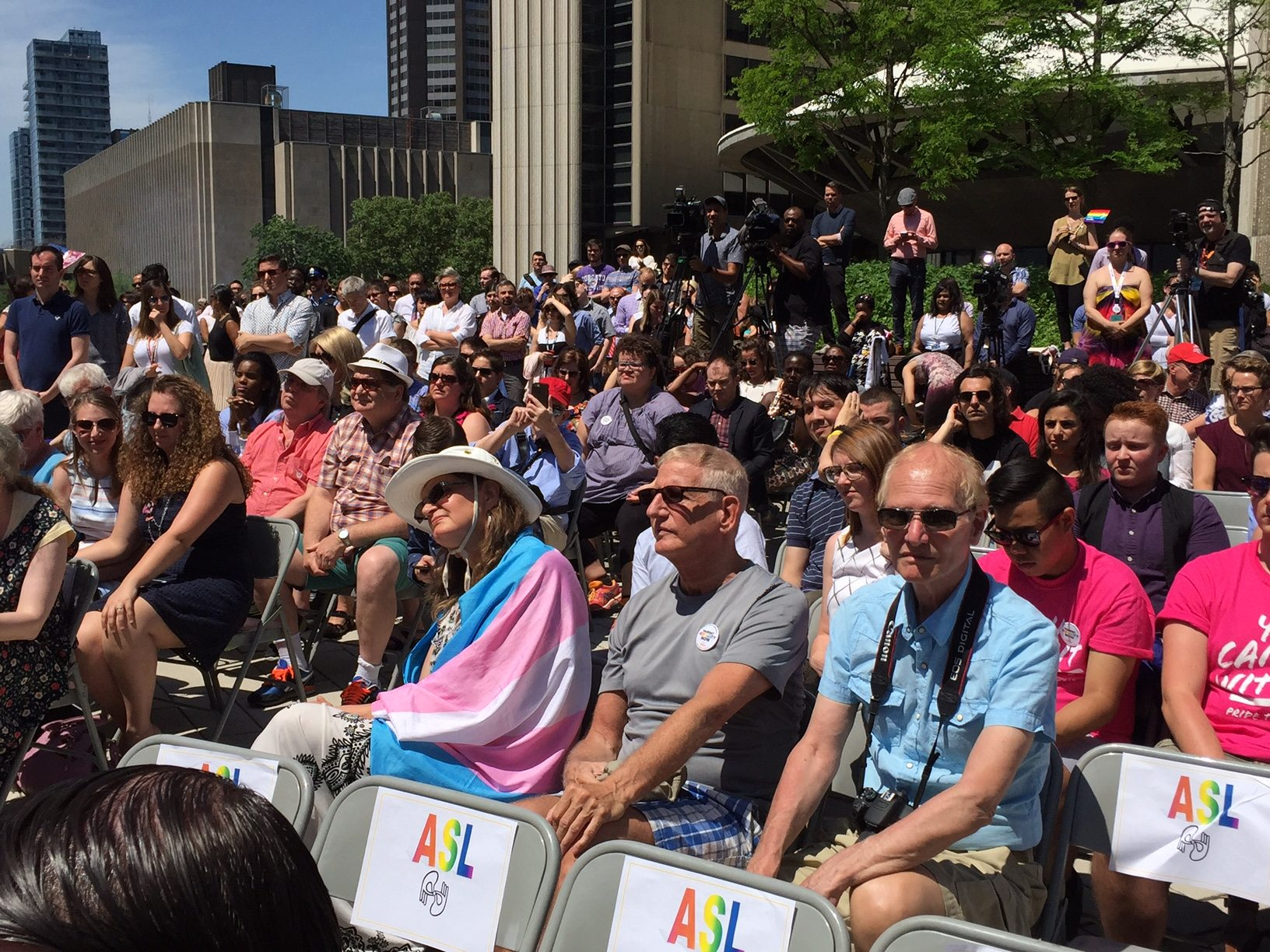 A full crowd gathered in the sweltering heat of the City Hall rooftop to celebrate.