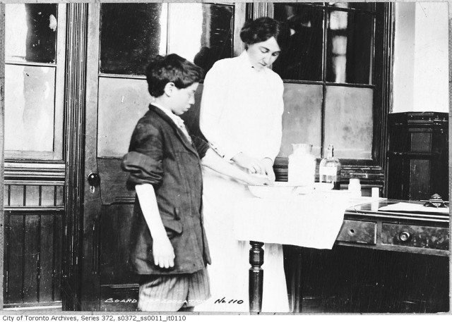 A public health nurse visits a school in 1914. From the Toronto Archives 	Fonds 200, Series 372, Subseries 11, Item 110.