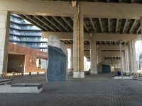 """Yard Stones"" by Adad Hannah are situated underneath the Gardiner by Bathurst and Fort York.  Photo: Beatrice Paez"