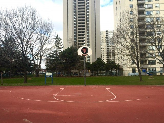 The basketball court donated by former Raptor Vince Carter sits between high rises on Dixon Road.
